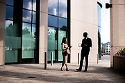 Coporate finance employees chatting outside offices in the business and commercial centre of St Helier, Jersey, CI