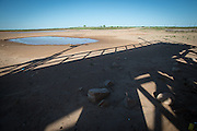 The shadow of the fishing dock at Lake Arrowhead State park reaches toward the ever-receding lake more than 100 yards in the distance. Lake Arrowhead State park is just south of Wichita Falls, Texas and the lake supplies the town with drinking water.
