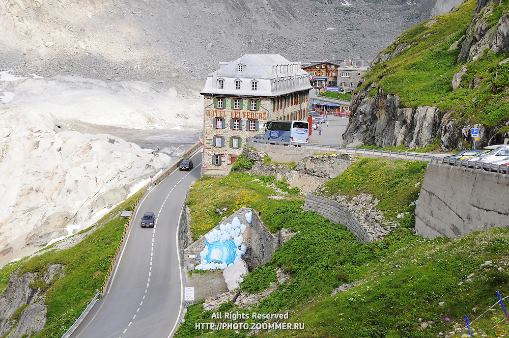 Hotel Belvedere by the road in Alps