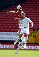Photo: Olly Greenwood.<br />Charlton Athletic v New Zealand. Pre Season Friendly. 05/08/2006. Charltons Hermann Hreidarsson and New Zealands Jarrard Smith