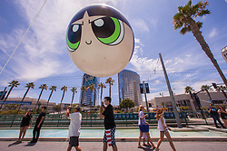 July 19, 2017 - San Diego, California, U.S. -  CAL FAZZIO from Corona, works on one of the last eight foot balloons to be anchored outside of Comic Con. (Credit Image: © Daren Fentiman via ZUMA Wire)