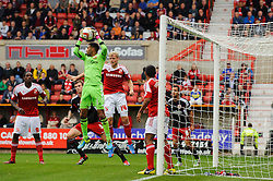 Swindon Goalkeeper Wes Foderingham (ENG) makes a save before Bristol City Defender Aden Flint (ENG) can get to the ball during the first half of the match - Photo mandatory by-line: Rogan Thomson/JMP - Tel: 07966 386802 - 21/09/2013 - SPORT - FOOTBALL - County Ground, Swindon - Swindon Town v Bristol City - Sky Bet League 1.