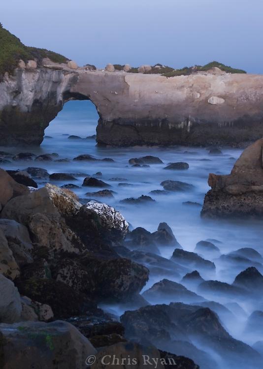 Dusk at the arch near Its Beach, Santa Cruz, California