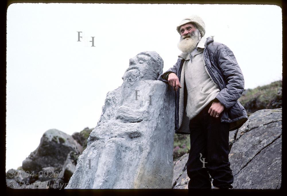 Sveinbjorn Beinteinsson, priest of 80-man Norse pagan religion, stands beside idol of Thor. Iceland