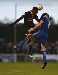 Tyreeq Bakinson of Newport County fouls Louis Birch of Metropolitan Police during the Emirates FA Cup first round match at Imber Court, London.