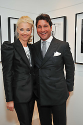 TAMARA BECKWITH and her husband GIORGIO VERONI at a private view of photographs by Marina Cicogna from her book Scritti e Scatti held at the Little Black Gallery, 3A Park Walk London SW10 on 16th October 2009.
