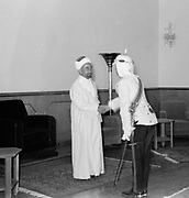 24th anniversary of Arab revolt under King Hussein & Lawrence 1940. The Emir being congratulated by Glubb Pasha.