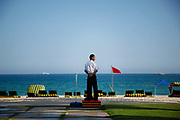 A security personnel guards a beach in Sanya, Hainan Province, China, on Tuesday, April 12, 2011. Leaders from Brazil, Russia, India, China, and South Africa, the main powers of the emerging economies, met on April 14 for 2011 BRICS Summit.
