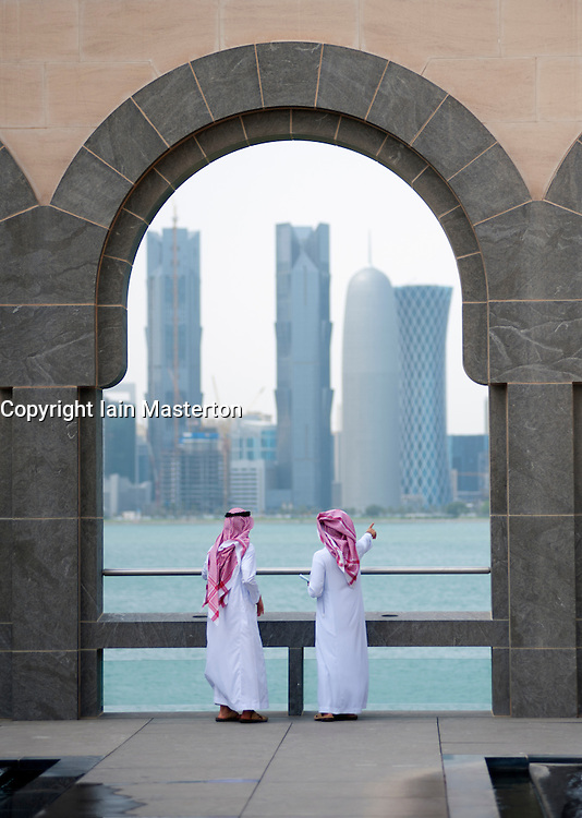 Museum of Islamic Art in Doha with skyline of city to rear , Qatar, architect IM Pei