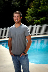 20120424 Brian Scott's salt water swimming pool is surrounded by woods with a screen porch that runs the length of the home, a pool house, and an outdoor grilling area.<br /> photo by Laura Mueller<br /> www.lauramuellerphotography.com