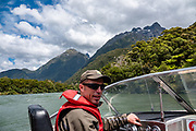 Jetboat from Lake McKerrow to Pyke River Confluence on Hollyford Track, Fiordland National Park, Southland region, South Island of New Zealand. We enjoyed an easy 3-day version of the Hollyford Track: Day 1: fly from Milford Sound to Martins Bay, walk to its oceanfront Hut, and see New Zealand fur seals. Day 2: jetboat on Lake McKerrow to Pyke River Confluence, hike to Hidden Falls Hut for overnight lodging. Day 3: tramp out to Hollyford Road end to our prearranged car shuttle. In 1990, UNESCO honored Te Wahipounamu - South West New Zealand as a World Heritage Area. To license this Copyright photo, please inquire at PhotoSeek.com .