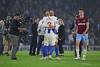 Football - 2018 / 2019 Premier League - Brighton and Hove Albion vs. West Ham United<br /> <br /> A dejected Declan Rice of West Ham United walks past a jubilant Glenn Murray and Bruno Salter of Brighton after the final whistle at The Amex Stadium Brighton <br /> <br /> COLORSPORT/SHAUN BOGGUST