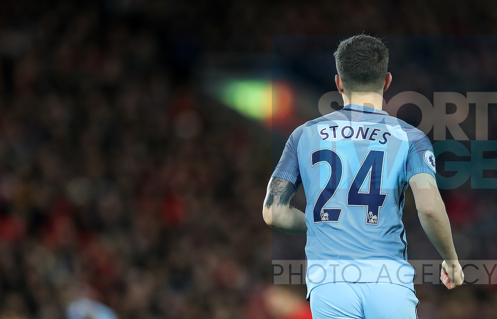 John Stones of Manchester City shows off his tattoos during the English Premier League match at Anfield Stadium, Liverpool. Picture date: December 31st, 2016. Photo credit should read: Lynne Cameron/Sportimage