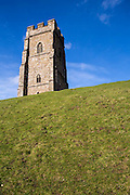 Glastonbury Tor, the ruins of St Michaels tower that sits on top of the hill in Glastonbury, Somerset. <br /> A prominent hill overlooking the Isle of Avalon, Glastonbury and the Somerset Levels. It has been a site of religious significance for over 1000 years and is considered one of the most spiritual sites in the United Kingdom, especially for Pagans. (photo by Andrew Aitchison / In pictures via Getty Images)