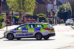 © Licensed to London News Pictures. 24/03/2019. LONDON, UK. A forensics officer and police officer attend an address at Marsh Road, Pinner, north west London, after being called at approximately 06:00hrs on 24 March to reports of a man found suffering injuries from a reported stabbing.  He was pronounced dead at the scene by officers and London Ambulance Service.  Enquiries are ongoing, no arrests have yet been made.  Photo credit: Stephen Chung/LNP