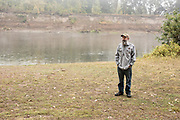 John Maier, Head Brewer at Rogue Ale & Spirits, stands on the banks of the Willamette River near the Rogue Farm