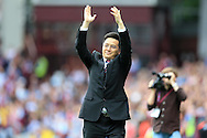 Dr Tony Xia , the new chairman of Aston Villa waves to the supporters before the game.EFL Skybet championship match, Aston Villa v Rotherham Utd at Villa Park in Birmingham, The Midlands on Saturday 13th August 2016.<br /> pic by Andrew Orchard, Andrew Orchard sports photography.