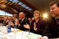 25 FEB 2004, DEMMIN/GERMANY:<br /> Eckard Rehberg (Mi-L), CDU Landesvorsitzender Mecklenburg-Vorpommern, und Angela Merkel (Mi-R), CDU Bundesvorsitzende, Politischer Aschermittwoch der CDU Mecklenburg-Vorpommern, Tennis- und SSquash Center Demmin<br /> IMAGE: 20040225-02-004
