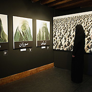 """VENICE, ITALY - JUNE 01:  A model poses in front of  Flavio Lucchini's works at the exhibition """"What Women Want (?)"""" on June 1, 2011 in Venice, Italy. The exhibition addresses the controversiat theme of the burqa"""