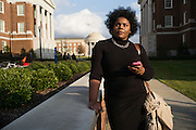 """TUSCALOOSA, AL – DECEMBER 10, 2015: Amanda K. Bennett, 21, walks to a meeting on the University of Alabama campus. Bennett, a senior English and African American studies major in the Honors College, organized the """"We are Done"""" campaign in 2015. """"I was motivated by years of letting systemic injustices and micro aggressions happen around me,"""" Bennett said. """"I realized that I could no longer be a passive bystander to inequality."""" CREDIT: Bob Miller for The New York Times"""