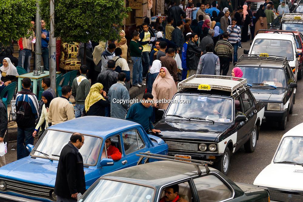 Egypt . Cairo : traffic jam and street life in sharia AL QALA street -,Muhammad Ali street , in Islamic Cairo