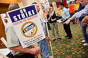 Nov. 11, 2009 -- PHOENIX, AZ: Union members hand out picket signs during a meeting of members of the UFCW at the Airport Marriott Hotel in Phoenix. The United Food and Commercial Workers Union (UFCW) Local 99 has about 25,000 members in Arizona: 15,000 in Fry's grocery stores and Fry's Marketplace, 9,500 in Safeway stores and 400 in Smith's grocery stores. The union voted down the last proposal from the stores and has announced plans to go on strike at 6PM on Friday, Nov. 13. The meeting Wednesday is the last one before the strike.   Photo by Jack Kurtz