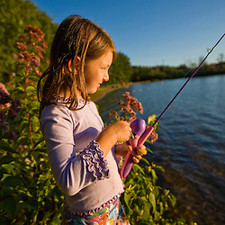 A girl fishing at Otter Lake in Greenfield State Park in Greenfield, New Hampshire.