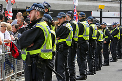 """© Licensed to London News Pictures. 03/08/2019. London, UK. Large police presence during """"Free Tommy Robinson Protest in central London. Last month Stephen Yaxley-Lennon, known as Tommy Robinson was given a nine-month prison sentence at Old Bailey after he was found guilty of contempt of court. Photo credit: Dinendra Haria/LNP"""