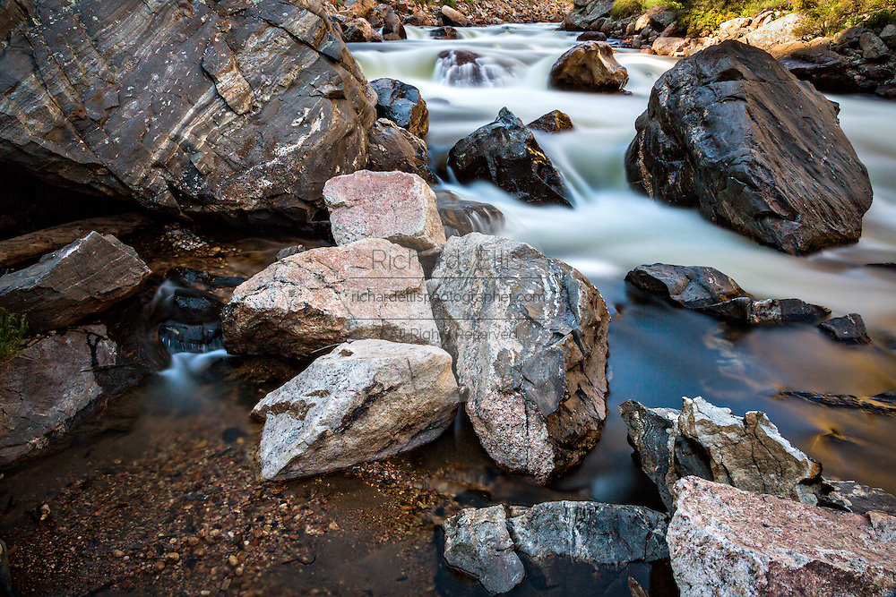 Rapid water flowing through the Cache la Poudre River in the Roosevelt National Forest near Rustic, Colorado.