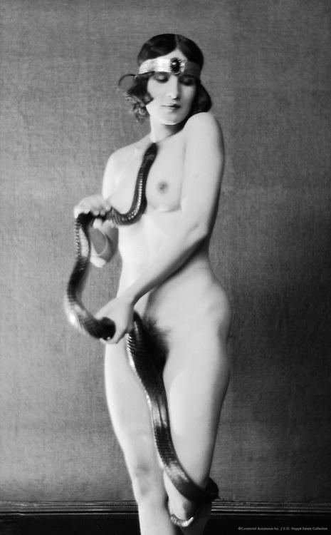 Diana Verne, dancer, holding a snake, 1922