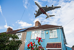 "London, UK. 17 June, 2019. An aircraft on the final approach to Heathrow airport passes over houses in Hounslow. On 18th June, Heathrow will publish its airspace and future operations consultation on its ""master plan"" for Heathrow expansion following approval in principle of a third runway by MPs last year. Heathrow is expected to increase the number of flights from the current cap of 480,000 per year imposed when Terminal 5 was built to 505,000 per year in 2021 and to 740,000 per year should a third runway be constructed."