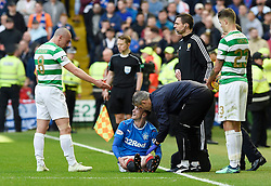 Celtic's Scott Brown urges Rangers' Andy Halliday to get up during the Ladbrokes Scottish Premiership match at Celtic Park, Glasgow.