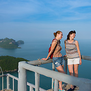 Two female tourists on top of the Ko Wua Ta Lap island in Ang Thong national marine park