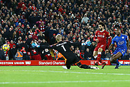 Mohamed Salah of Liverpool shoots past Leicester goalkeeper Kasper Schmeichel and scores his teams 2nd goal to make it 2-1. Premier League match, Liverpool v Leicester City at the Anfield stadium in Liverpool, Merseyside on Saturday 30th December 2017.<br /> pic by Chris Stading, Andrew Orchard sports photography.