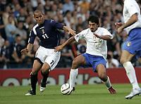 Glasgow, Scotland 3-9-05<br /> World Cup 2006 qualifing match<br /> Scotland-Italy<br /> nella  foto Quashie e Gattuso<br /> Foto Snapshot / Graffiti