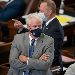 Austin, TX USA March 31, 2021:  State Rep. Lyle Larson, R-San Antonio, on the floor of the Texas House of Representatives during routine bill readings at the 87th Texas legislative session. Emergency bills include power company regulation, border security and the coronavirus response.