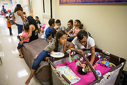 September 9, 2017 - Florida, U.S. - LOREN ELLIOTT   |   Times .Tiana Burgos brushes the hair of 3-month-old daughter Amelia Polanco, as extended family member Alianis Burgos, 9, watches, at a hurricane shelter inside Kingsway Elementary School in Port Charlotte, Fla., on Saturday, Sept. 9, 2017. The shelter had over 900 people checked in Saturday afternoon in anticipation of Hurricane Irma. (Credit Image: © Loren Elliott/Tampa Bay Times via ZUMA Wire)