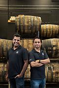 Vishal Gauri and Virag Saksena (right) pose for a portrait at 10th Street Distillery in San Jose, California, on September 4, 2019. (Stan Olszewski for Content Magazine)