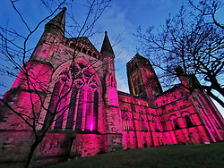 © Licensed to London News Pictures. 14/03/2021. Durham, UK. Durham Cathedral is bathed in purple light as a tribute to former Durham University Student Sarah Everard. Ms Everard went missing as she walked home across Clapham Common on March 3rd, 2021 - a serving police officer, constable Wayne Couzens, has been charged with her kidnap and murder. Photo credit: Colin Scarr/LNP