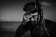 A diver is getting ready for the first dive of the day.