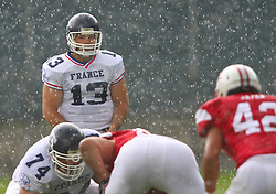 11.07.2011, UPC Arena, Graz, AUT, American Football WM 2011, Group B, Japan (JAP) vs France (FRA), im Bild Max Sprauel (France, #13, QB ) waits for the snap while heavy rain starts // during the American Football World Championship 2011 Group B game, Japan vs France, at UPC Arena, Graz, 2011-07-11, EXPA Pictures © 2011, PhotoCredit: EXPA/ T. Haumer