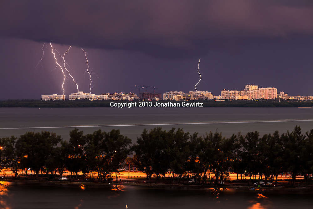 Nocturnal cloud to ground lightning over the Atlantic Ocean off Key Biscayne, Florida. The Rickenbacker Causeway in the foreground. WATERMARKS WILL NOT APPEAR ON PRINTS OR LICENSED IMAGES.