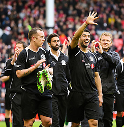 Charlie Adam and Luis Suarez acknowledge the crowd - Photo mandatory by-line: Dougie Allward/JMP - Mobile: 07966 386802 - 29/03/2015 - SPORT - Football - Liverpool - Anfield Stadium - Gerrard's Squad v Carragher's Squad - Liverpool FC All stars Game