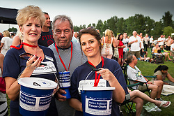 Volunteers collecting for the Helen Rollason Cancer Charity at the Brentwood Festival. Essex UK 2014