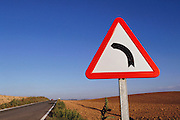 "One of many ""curved road ahead"" signs near the town of Artajona, in Navarra, Spain."