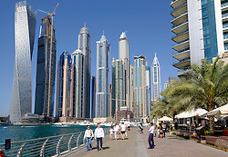 Skyline of skyscrapers and waterside promenade  in  Marina district of Dubai United Arab Emirates