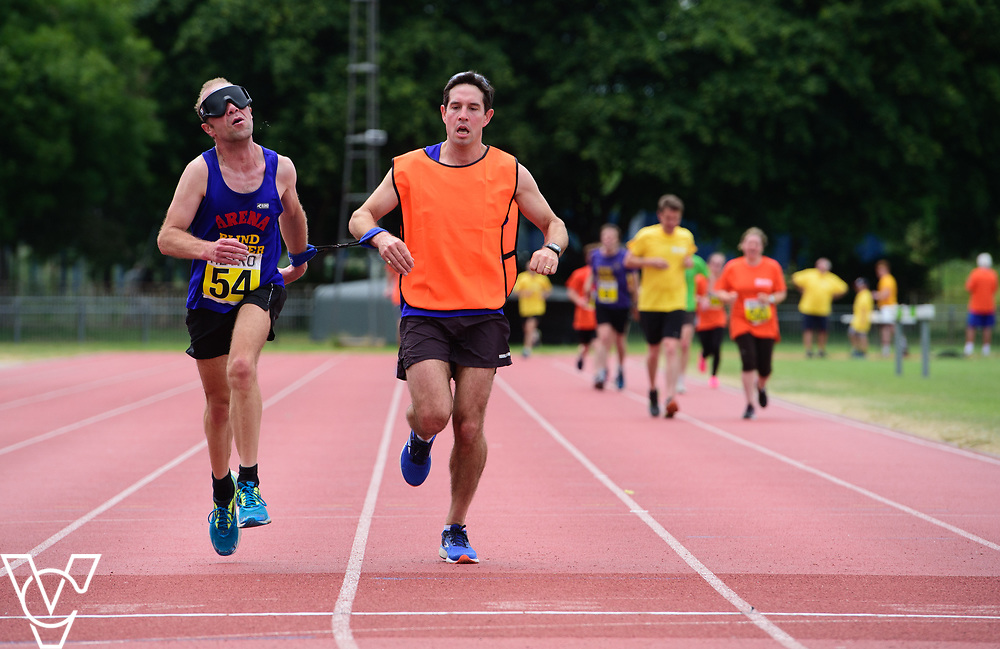 Event: 5000 meter relay<br /> Competitors, from left: Keith Turner<br /> <br /> Metro Blind Sport's 42nd Athletics Open, held at Mile End Stadium, Tower Hamlets, London.<br /> <br /> Picture: Chris Vaughan Photography for Metro Blind Sports<br /> Date: June 16, 2018