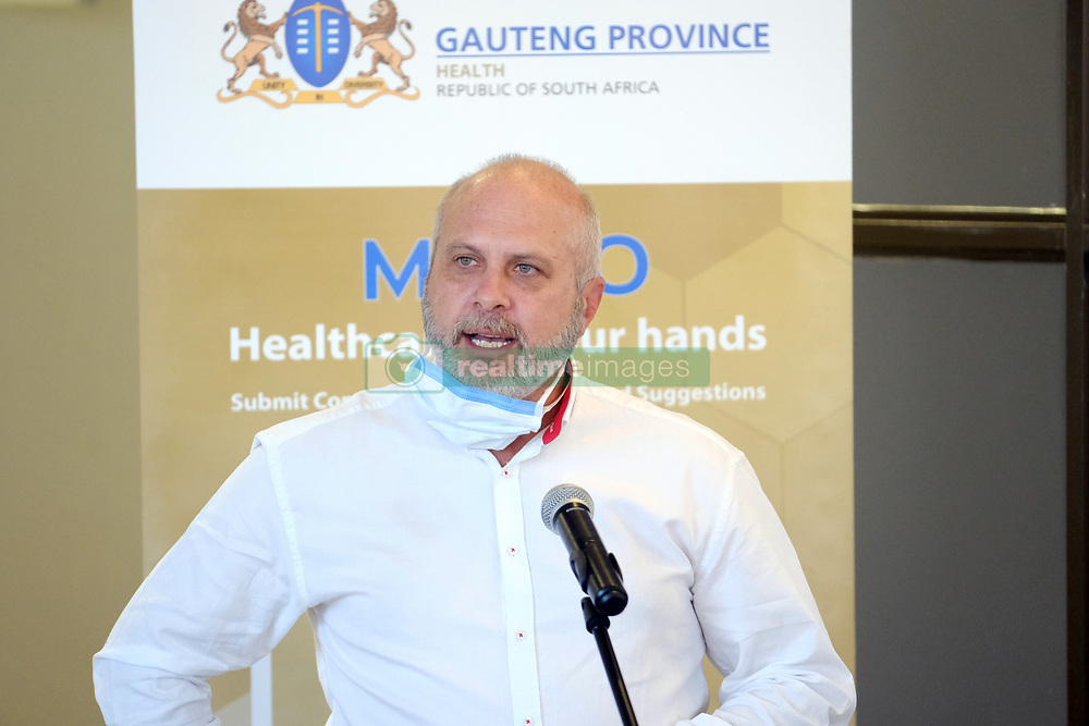JOHANNESBURG, SOUTH AFRICA - APRIL 25: Gauteng Regional Manager for Defy, Christo Hitge discussing produciton of ventilators and appliance donations at a handover by various stakeholders at the Nasrec quarantine site currently under construction. With isolation units, consultation areas, ICU capabilitiies, medical facilities, power points, drainage and ablutions, the quarantine site will have a total bed capacity of 2300 on April 25, 2020 in Johannesburg South Africa. Under pressure from a global pandemic. President Ramaphosa declared a 21 day national lockdown extended by another two weeks, mobilising goverment structures accross the nation to combat the rapidly spreading COVID-19 virus - the lockdown requires businesses to close and the public to stay at home during this period, unless part of approved essential services. (Photo by Dino Lloyd)
