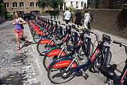 London Cycle Hire bicycles at a docking station. The scheme, sponsored by Santander is intended to get Londoners cycling. As part of a major initiative. These free (for the first half hour) bikes are then charged for how long you use them. Take a cycle, ride it where you like, then return it, ready for the next person. Available 24 hours a day, all year round. It's self-service and there's no booking. Just turn up and go.