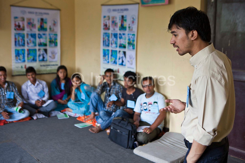 Sanjog Thakuri leads a training session in life skills in Bisaneu Voice of Children centre in Kathmandu, Nepal.  His teenage students sit on the floor in the class room. The session is part of the rehabilitation program run by Voice of Children.  The not-for-profit organisation supports street children and those who are at risk of sexual abuse through educational and vocational training opportunities, health services and psychosocial counseling.
